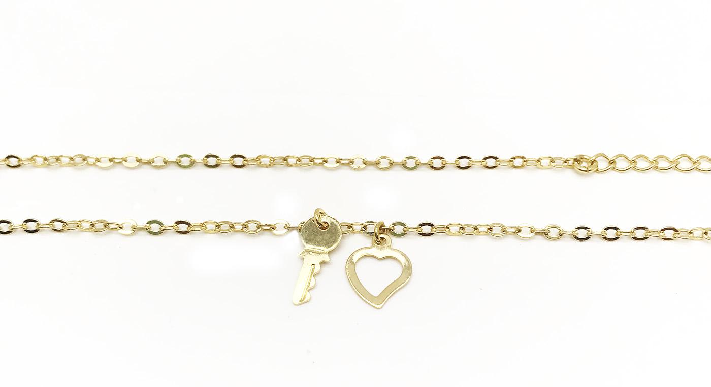 Tornozeleira com pingente de coração e chave folheado a ouro 18k