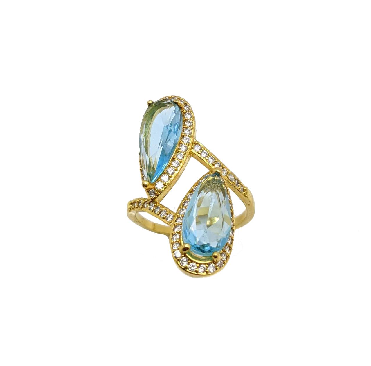 Anel Cravejado com Duas Pedras Azul Clara Folheada a Ouro 18K